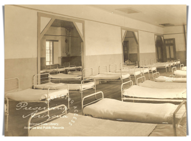 Image of beds in the dorm room at Fort Grant
